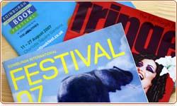 Stack of Festival programmes